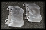 Photo of a set of 4 titanium brake heat shields.